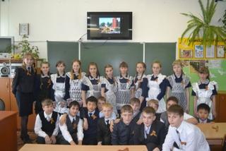 Полицейские и школьники провели акцию «Георгиевская лента» в Уссурийске